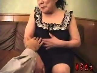 Horny Japanese granny enjoys an intense fucking on the bed