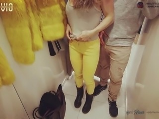Fit girl fucks and swallows cum at the fitting room