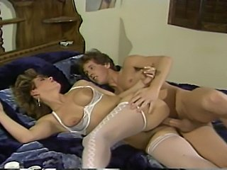Ginger Lynn gets boned by Peter North and Erica Boyer gets it anally from Tom...
