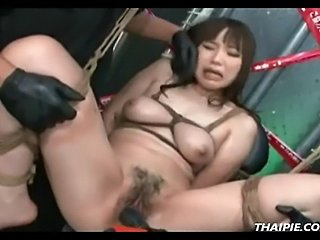 Hairy Asian tied with ropes and masturbated with toys