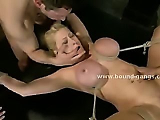 Blonde busty woman is fuck in bondage rough fetish gang bang sex
