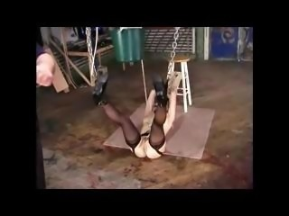 Young blonde slave girl gets punished on the warehouse floor