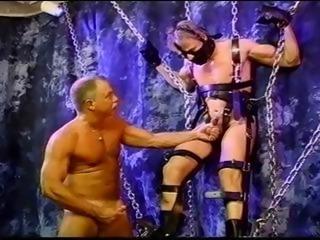 Blond muscle stud is suspended as he gets his balls bashed and szueezed.