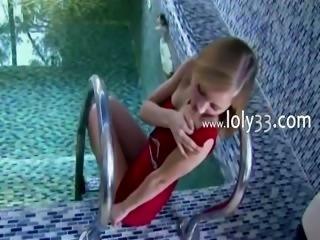 Beautiful woman teasing on swimming pool