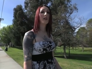 Alternative tranny Brittany St Jordan with red hair, pale skin