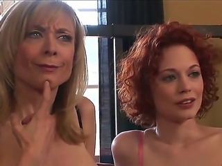 Two attractive and appetizing milf pornstars Justine Joly and Nina Hartley in...