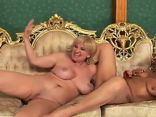Orhidea and Sally G. were just lying there on the couch and pleasing each...