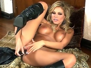 Mature blonde Nicole Graves loves to feel her tight pussy getting wet and warm