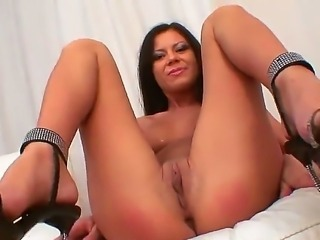 Young looking dark haired babe Sintia with natural perky boobs and long sexy...