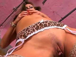 Stunning wild brunette hottie Sandy with arousing heavy make up and perky...