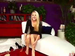 The wonderful blonde pornstar Ashley Stone masturbates her shaved pussy in...