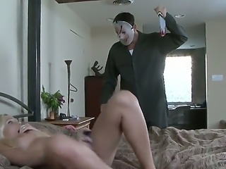 Kinky blonde Jordan Sparx gives a blowjob to a scary dude with a mask in her...
