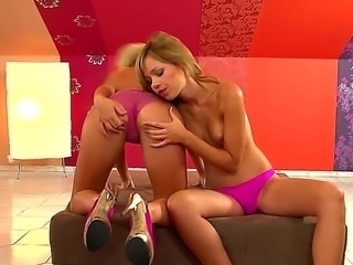 Well-to-do Natalia Forrest takes one large nipple of her GF in the mouth and...