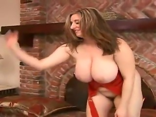 Amazing busty mature whore Kitty Lee showing off her colossal breasts and...
