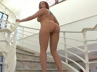 Kelly Divine stands on her four with access to her astounding genitalia....