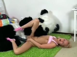 Innocent-looking blonde schoolgirl Amelie Pure fucks with her panda lover on...