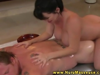 Busty asian massage beautie sensually rubbing down client in moist massage