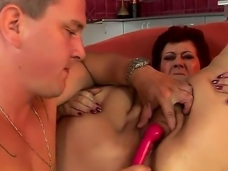 Plump bature chick Hetty is being screwed with a dildo before she munches on...