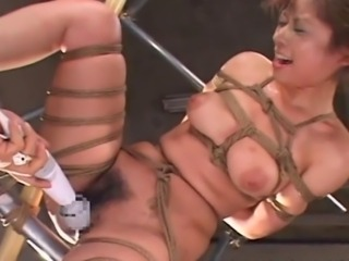 This kinky Asian gal can't get off unless she is tied up tightly using...