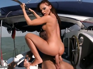 Brunette Christina Bella with massive tits takes cock up the ass