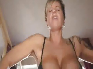 Busty amateur fucks a huge cola bottle and fisted