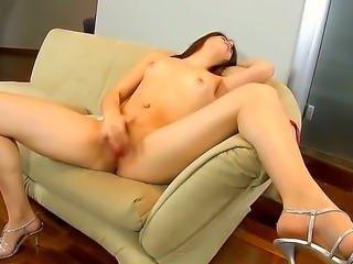 Sweet Isabel loves the satisfying sensation of her trembling shaved pussy as...