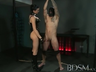 Slave boy gets tied up and receives more than he bargained for from horny...