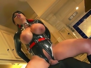 Latex-clad Kerry Louise with giant boobs takes on big cock in the kitchen