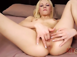 Blonde April Paisley with tiny tits and bald muff bares it all and...