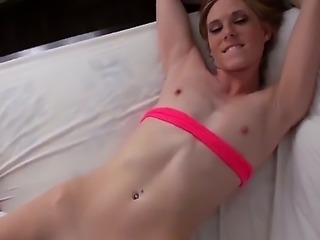 Ella Woods is a small tits blonde that likes lying on her back while she...
