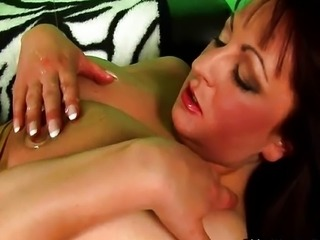 MILF with big tits masturbates in stockings