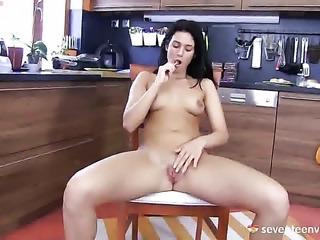 Betty K fucking herself with dildo
