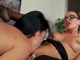 Two girls, Sandy and Breanne Benson are on top of the desk in the office. To...