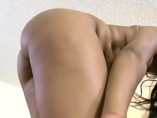 Ebony girl is massaging a cock with her firm natural tits. The brunette...