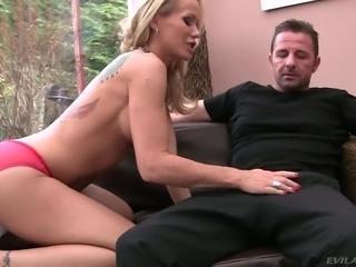 Blonde haired MILF Simone Sonay with hot boobs pulls her red panties aside...