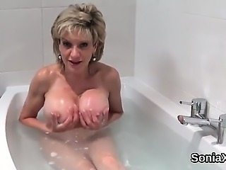 Cheating english mature lady sonia flashes her massive breas