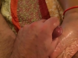 Stroke out cum onto soles