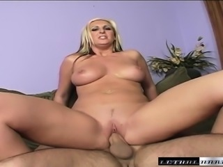 Kinky blonde Emilianna teases Andrew with a foot job and a titty fuck