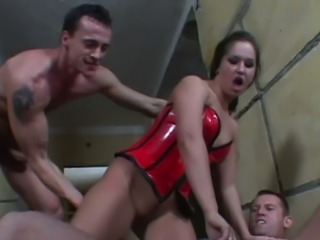 Dark haired dirty bitch in red latex corset Yvette Balcano gets DPed hard