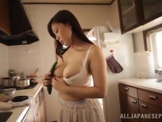 Eri Hosaka fingers her Japanese pussy in the kitchen