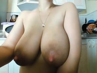 Milk maiden sucking her nipples