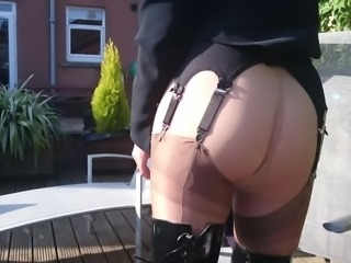 Outdoors in Fife in my patent thigh  boots and sheer tights.