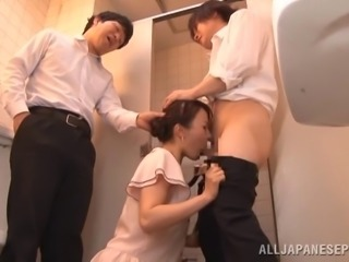Two students fuck their Asian teacher's mouth in the bathroom