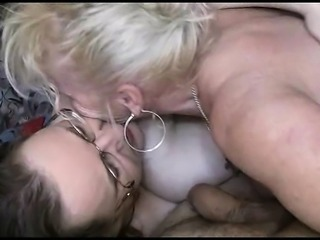 Two fat old lezzies with huge tits take turns sucking on his prick