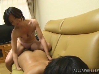 Japanese cougar with a great body sucking her boyfriend's big cock