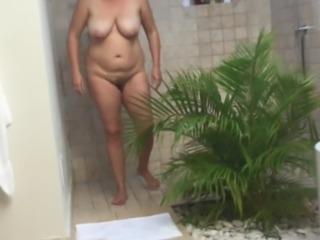 hidden cam catches unaware holiday MILF in shower