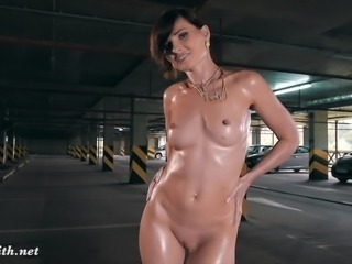 Jeny Smith oiling her naked body in a public parking
