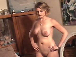 Horn-mad short haired sinful blonde tries to wank her pussy a bit on cam