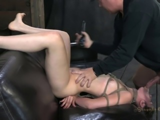 Tied bondage dame giving big cock superb blowjob in BDSM shoot