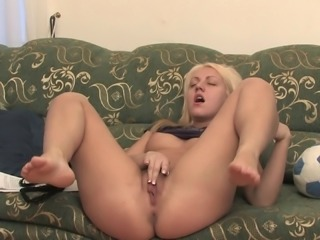 A sporty blonde has some erotic fun rubbing her pussy